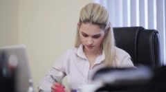 Beautiful business woman working in the office - stock footage