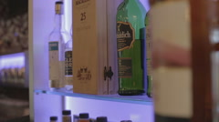 Slider shot in a bar with Scotch whisky Stock Footage