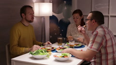 Friends having dinner at the table and talk Stock Footage