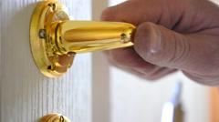 Mounting a mortise door lock. Fastening door handle screw Stock Footage