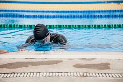 Competitor Getting ready by Doing a Wet Warm-up - stock photo
