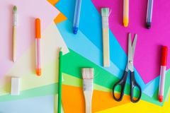 Set of different colors felt-tip pens, pencils, brushes and colored paper - stock photo