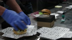 Packaging burgers in boxes for home delivery clients Stock Footage