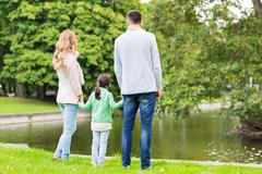 Family walking in summer park Stock Photos