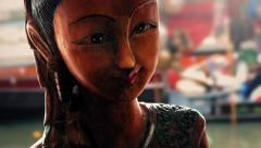 Carved Wooden Statue Of Woman With Boats Passing Behind Stock Footage