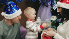 Happy family having fun with Christmas presents at home - stock footage