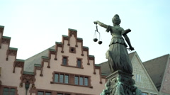 Statue holding scale representing Justice in Roemer area Frankfurt 4k Stock Footage
