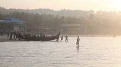 Indian fishermen in silhouette at sunrise Stock Footage