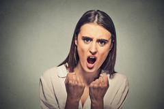 Angry frustrated woman screaming Stock Photos