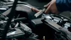 Serviceman repairing car engine Stock Footage