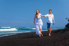 Just married happy family on tropical island honeymoon holidays Stock Photos
