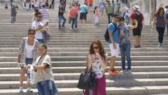 Tourists taking selfies on the steps of the Altare della Patria, Rome, Italy. - stock footage