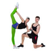 Aerobics fitness couple exercising isolated in full body - stock photo