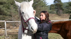 Horse rehabilitation center for children retarded development putting on harness - stock footage