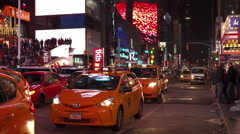 Taxi vehicles in downtown Times Square at stop light 4k Stock Footage