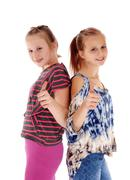 Two sisters showing thump up. - stock photo
