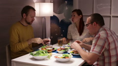 Family eating at the table and talk - stock footage