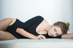 Stock Photo of Slim woman with complexes