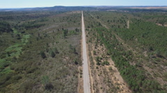 Straight road in the countryside, aerial view Stock Footage