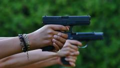 Gun shooting range two guns glocks/beretta close up shooting the same time Stock Footage