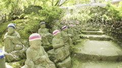 Dynamic shot of the 500 statues of the garden of Daisho-in Temple, Miyajima Stock Footage
