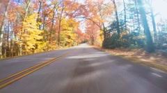 Autumn driving shot of the Blue Ridge Parkway at sunset Stock Footage