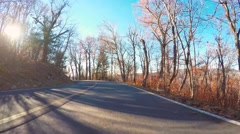 Autumn driving shot of the Blue Ridge Parkway at sunset - stock footage