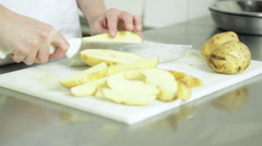 Woman cutting potatos - stock footage