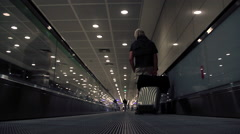 Passenger with trolley in airport sliding scale Stock Footage