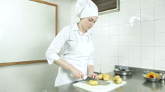 Woman cutting potatos Stock Footage