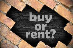 Hole in the brick wall with word buy or rent? Stock Photos