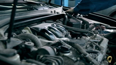 Serviceman carries out maintenance of the vehicle Stock Footage