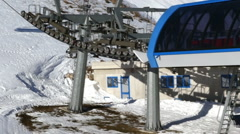 Skiers on chairlift - stock footage