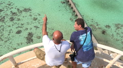 Aerial view of two men on top of lighthouse in Sudan, Red sea, Sanganeb reef Stock Footage