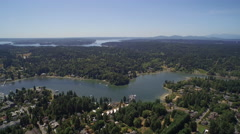 Aerial view. Flight over Eagle Harbor Marina - Bainbridge Island Stock Footage