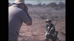 Vintage 16mm film, 1972, Kenya, hunter dead African Oryx pose Stock Footage