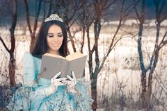Beautiful Snow Queen Reading a Book - stock photo