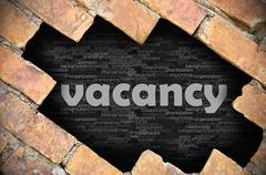 Hole in the brick wall with word vacancy - stock photo