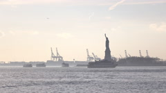 Lady Liberty with tourist boats surrounding Liberty Island 4k - stock footage