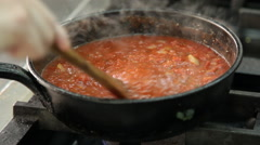Woman stirs tomato sauce Stock Footage