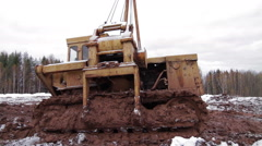 Tractor rides through mud Stock Footage