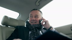 Businessman waiting for a partner in the car Stock Footage
