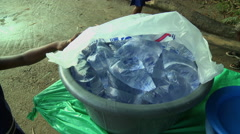 BUCKET OF SACHET WATER PACKETS Stock Footage