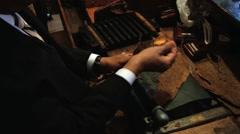 Man produces a cigar in Punto Cana, Dominican Republic. - stock footage