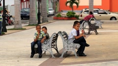 People relax at the central square of the Puerto Plata, Dominican Republic. Stock Footage