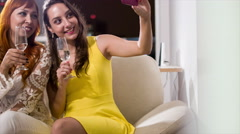 After New Year's party, two friends take pictures to post on social networks - stock footage