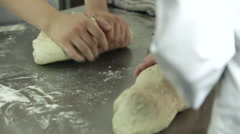 Woman's hands knead the dough Stock Footage