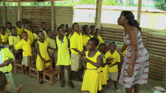 PAKRO: YOUNG STUDENTS AND TEACHER SING IN CLASSROOM Stock Footage
