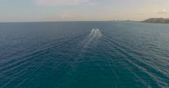 Aerial trailing behind a speeding boat in the ocean. Stock Footage