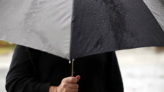 Faceless Man Holding Umbrella In The Rain Stock Footage